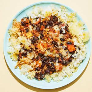 Cheesy Black Beanswith Crispy Rice & Tomatoes