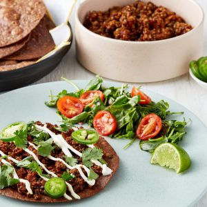 Vegetarian Tostada with Quinoa, Lentils & Hot Honey Salad