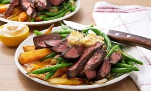steak frites with sautéed green beans and garlic butter